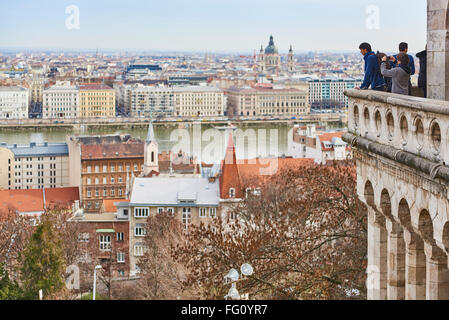 BUDAPEST, HUNGARY - FEBRUARY 02: Tourists enjoying the view on balcony at Fisherman's Bastion, at the Old Town district, - Stock Photo