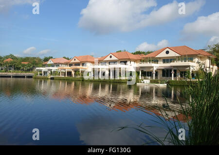 A residential houses around a lake Soi Nichida Thani in Pakkret, Northern Bangkok suburbs - Stock Photo