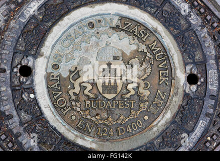 BUDAPEST, HUNGARY - FEBRUARY 02: Detail of ornamented manhole cover at the Old Town district. February 02, 2016 - Stock Photo