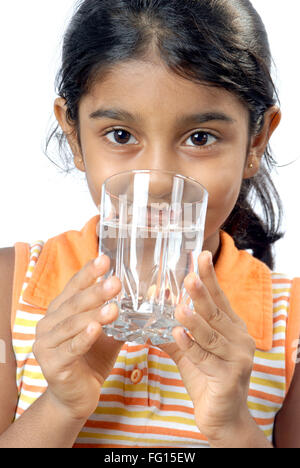 South Asian Indian girl holding glass full of mineral water and drinking MR#152 - Stock Photo