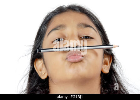 Young naughty girl kept pencil above lips MR# 152 - Stock Photo