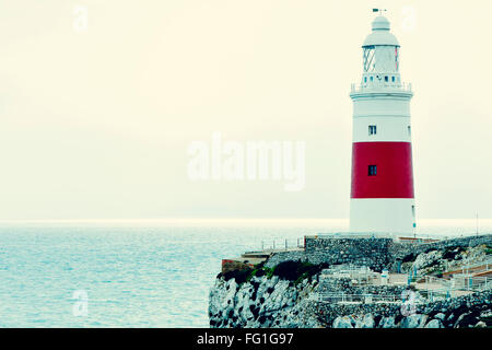 a view of the Trinity Lighthouse at Europa Point, in Gibraltar, and the Mediterranean sea - Stock Photo