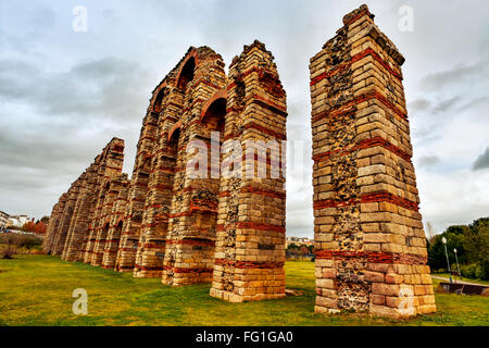 a view of the remains of the ancient roman aqueduct Acueducto de los Milagros in Merida, Spain - Stock Photo