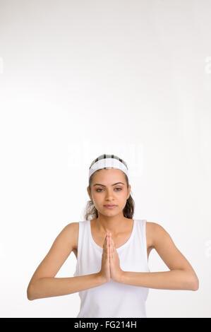 Portrait of a girl doing her meditation ; Pune ; Maharashtra ; India MR#686M 12 07 2010 - Stock Photo