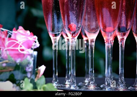 Cocktails In Flutes On Table - Stock Photo