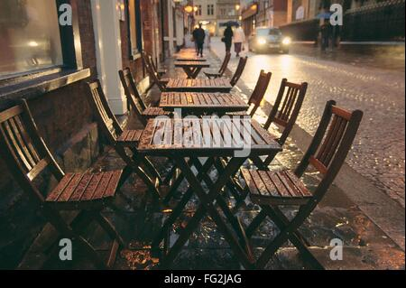 Empty Chairs And Tables In Sidewalk Cafe - Stock Photo