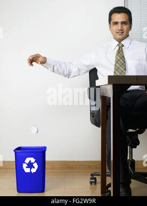 Executive throwing crumpled paper in dustbin MR#779K - Stock Photo
