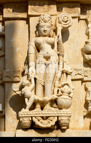 Statue carved on wall of Jagat Shiromani temple , Jaipur , Rajasthan , India - Stock Photo