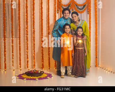 Family celebrates diwali festivals MR#779P ; MR#779Q ; MR#779R ; MR#779S - Stock Photo