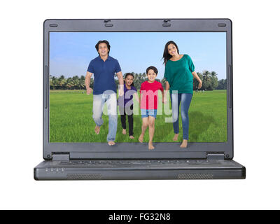 Family coming out of a laptop MR#779P ; MR#779Q ; MR#779R ; MR#779S - Stock Photo