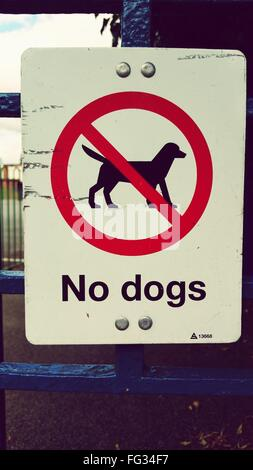 No Dogs Allowed Sign On Gate - Stock Photo