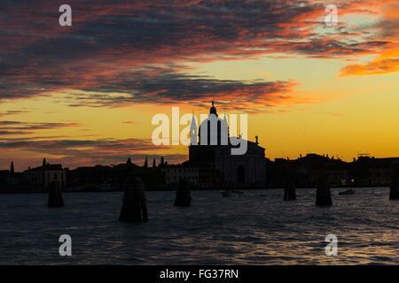 Silhouette Santa Maria Della Salute By Sea Against Sunset Sky - Stock Photo