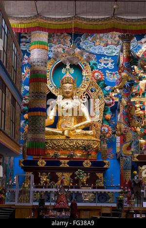 Golden statue in Namdroling monastery Palyul Nyingmapa Buddhist Centre Byalakuppe ; Mysore District ; Karnataka - Stock Photo