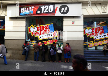 ... People Standing Outside Discount Store Offering Crazy Price Reductions,  La Paz, Bolivia   Stock