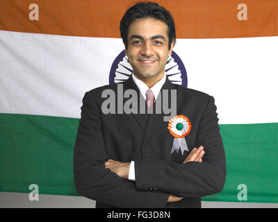 Executive folded hands standing in front of national flag of India MR#702A - Stock Photo