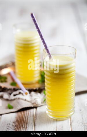 Juice from fresh pineapple, apple and lemon - Stock Photo