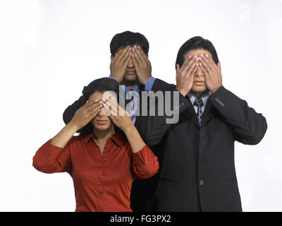 South Asian Indian executive men and woman covering eyes MR - Stock Photo