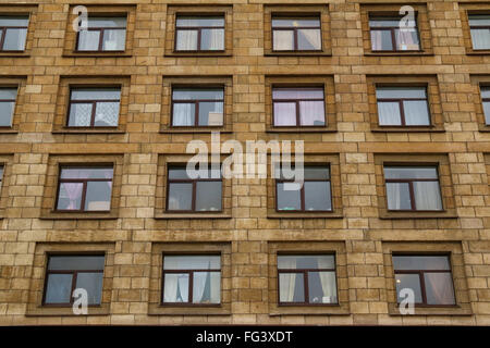 Apartment Building Front many windows in row on facade of urban apartment building front