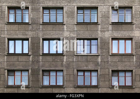 Many windows in row on facade of urban apartment building front view, St. Petersburg, Russia - Stock Photo