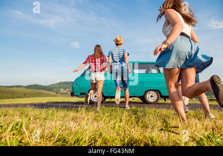 Running couples in love, outside against blue sky - Stock Photo