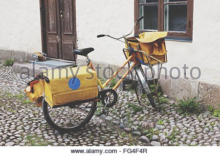 Side View Of Parked Bicycle Against The Wall - Stock Photo