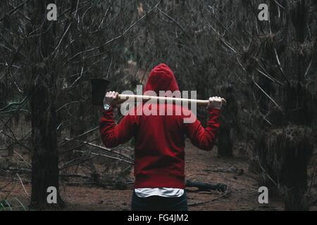 Rear View Of Person In Hooded Shirt Walking In Belanglo State Forest - Stock Photo