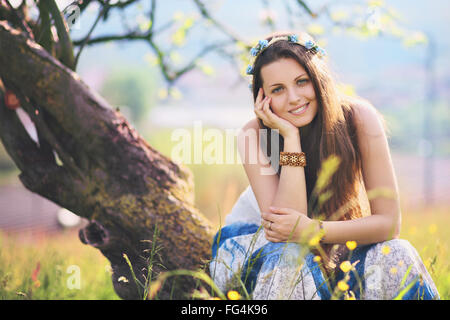 Smiling and joyful woman in spring meadow. Nature and harmony - Stock Photo