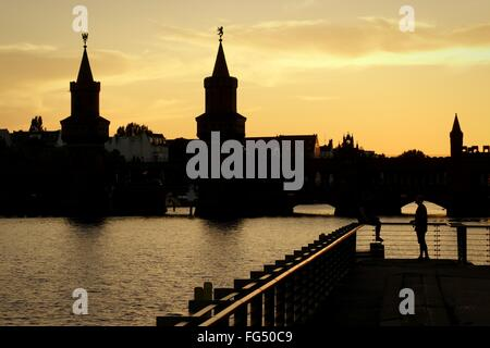 Oberbaum Bridge Over Spree River Against Sky At Sunset - Stock Photo