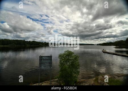 Scenic View Of Lake Against Cloudy Sky At Dusk - Stock Photo