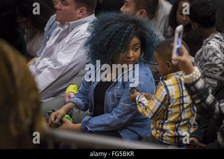 Minneapolis, Minnesota, USA. 13th Feb, 2016. A woman and a child in the audience at a Bernie Sanders campaign event. Senator Bernie Sanders of Vermont, who is seeking the Democratic Party nomination for president, attended the Black America Forum, sponsored by MN Neighborhoods Organizing for Change at Patrick Henry High School in the largely African-American neighborhood of North Minneapolis, Minnesota on Friday, February 12, 2016. After beating Hillary Clinton in the New Hampshire primary earlier in the week, Sen. Sanders began campaigning in earnest for minority voters, who will b
