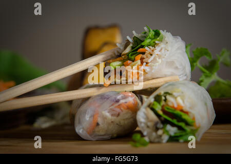 Vietnamese summer rolls surrounded with rice paper and stuffed with various vegetables. Vegetarian food. Asian food. - Stock Photo