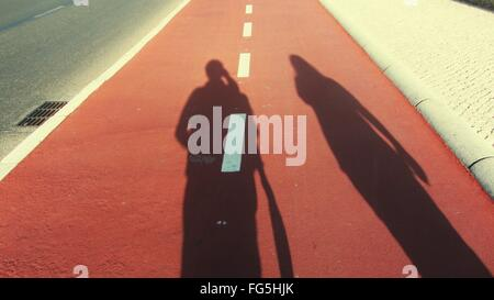 Man And Woman Shadow On Street - Stock Photo