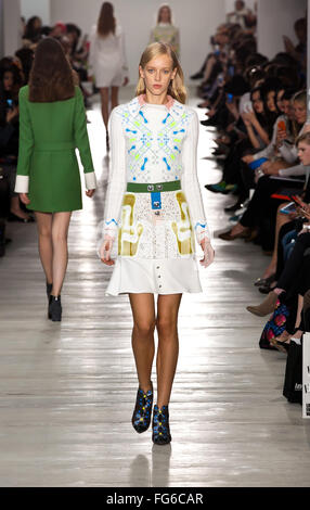Model walking down the catwalk showcasing Peter Pilotto's collection at London Fashion Weekend 2015 - Stock Photo