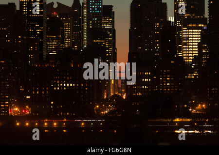 Twilight scene detail of Midtown Manhattan skyscrapers, FDR drive and East 57th Street in New York City, USA. - Stock Photo