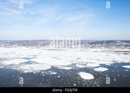 View of Hastings-on Hudson in winter, with ice on the Hudson RIver. - Stock Photo