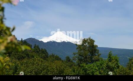 Views of the Villarica volcano and Lago Villarica from rural farmland near Pucon, Araucania, Chile - Stock Photo