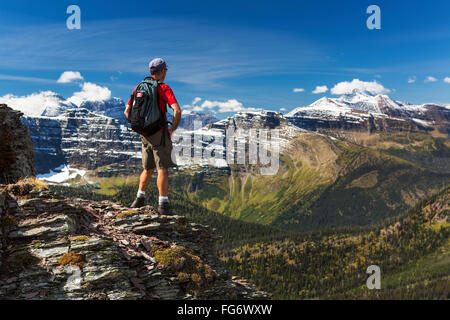 Male hiker on mountain overlooking puerto de mogan gran - Standing canarias ...