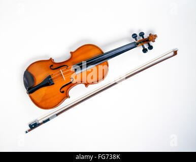 Still-life of violin and bow with white background, London, England, United Kingdom - Stock Photo