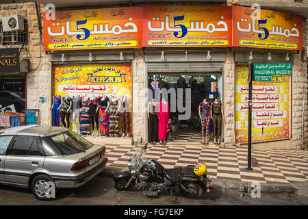 A street scene with shops and stores in the old city of Amman, Hashemite Kingdom of Jordan, Middle East. - Stock Photo