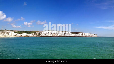 Sea And White Cliffs Of Dover Against Blue Sky - Stock Photo