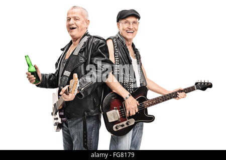 Senior male punk rock bass player and guitarist posing together isolated on white background - Stock Photo