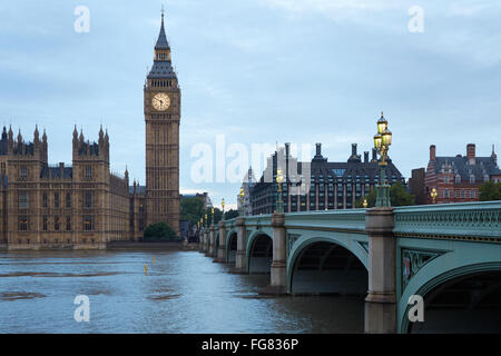 Big Ben and bridge in the early morning in London, natural colors and lights - Stock Photo