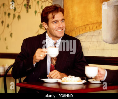 Young city business man in cafe, City of London, London, England, United Kingdom - Stock Photo