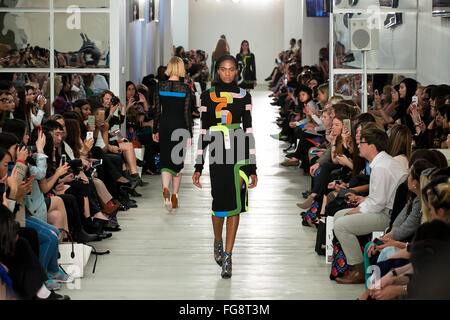 Model walking down the catwalk at London Fashion Weekend 2015 showcasing Peter Pilotto outfit - Stock Photo