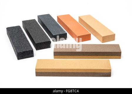 Sharpening stones set of 7 on white background - Stock Photo
