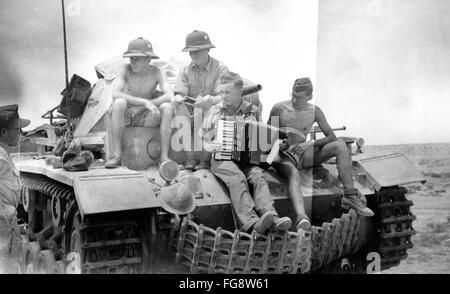 The Nazi propaganda picture shows Afrika Korps soldiers of the German Wehrmacht on a tank in North Africa. Date - Stock Photo