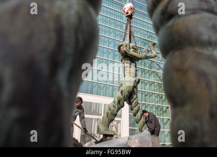 Workers lift a sculpture at the Philharmonic in Essen, Germany, 18 February 2016. During the dismantling of three - Stock Photo