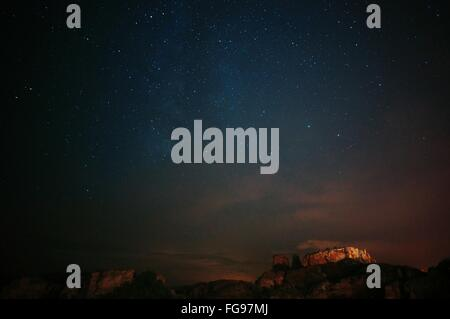 Scenic View Of Mountains Against Star Field At Night - Stock Photo