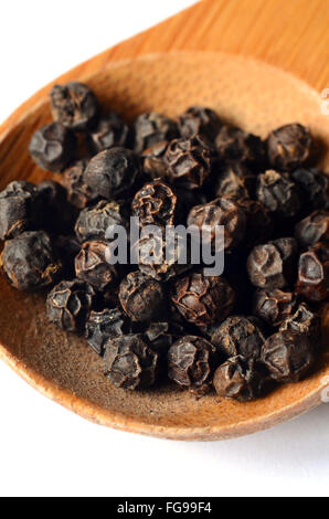 Close-up of black peppercorns, shot with a macro lens - Stock Photo