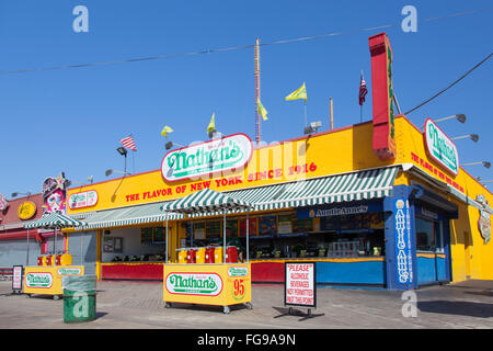 new york city, 15 september 2015: nathan's famous restaurant in bright colors on coney island on sunny morning - Stock Photo
